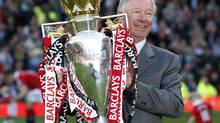Manchester United's manager Alex Ferguson holds the English Premier League trophy following their English Premier League soccer match against Blackpool at Old Trafford, northern England, in this May 22, 2011 file photo. Sir Alex will retire at the end of the season after more than 26 years in charge, bringing to a close the most glittering managerial career in British soccer. (DARREN STAPLES/REUTERS)