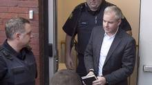 Dennis Oland heads from court in Fredericton, on Oct. 24, 2016. (Andrew Vaughan/THE CANADIAN PRESS)
