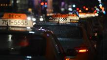 Taxis cueing up on King St. West outside First Canadian Place in downtown Toronto on March 12 2013. (Fred Lum/The Globe and Mail)
