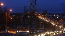 Early morning commuter traffic builds up on the Angus L. Macdonald bridge, which spans Halifax harbour. (PAUL DARROW FOR THE GLOBE AND MAIL)