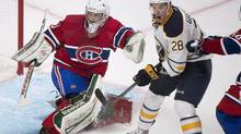Buffalo Sabres' Zemgus Girgensons (28) moves in on Montreal Canadiens' goaltender Zachary Fucale during second period NHL pre-season hockey action in Montreal, Sunday, September 15, 2013. (GRAHAM HUGHES/THE CANADIAN PRESS)