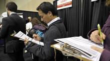 Hundreds line up for various booths at the National Job Fair and Training Expo at the Metro Toronto Convention Centre, 2012. (J.P. Moczulski for The Globe and Mail/J.P. Moczulski for The Globe and Mail)