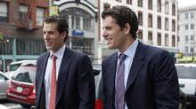 Cameron and Tyler Winklevoss leave the 9th Circuit Court of Appeals after a hearing on a settlement dispute with Facebook's Mark Zuckerberg in San Francisco, California January 11, 2011. (STEPHEN LAM/REUTERS)