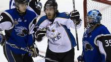 Saint John Sea Dogs goaltender Alexandre Theriault (right) and forward Nathan Beaulieu (28) react as Kootenay Ice forward Kevin King (centre) celebrates his goal during second period Memorial Cup action in Mississauga, Ontario, on Tuesday, May 24, 2011. THE CANADIAN PRESS/Frank Gunn (Frank Gunn/CP)