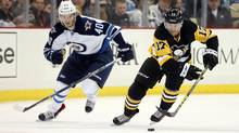 Pittsburgh Penguins right wing Bryan Rust (17) skates with the puck ahead of Winnipeg Jets right wing Joel Armia (40) during the second period at the CONSOL Energy Center in Pittsburgh on Saturday, Feb. 27, 2016. (Charles LeClaire/USA Today Sports)