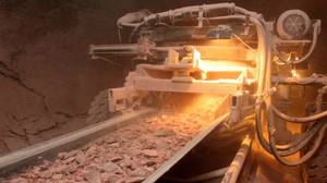Potash drilled from the earth is carried up to the surface on a conveyor belt where it is processed into a usable product.