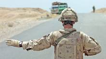 A reservist in Afghanistan: Without 'augmentees,' the land forces could not readily do the job. (Joe Bryksa)