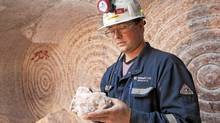 A Potash employee presents a sample of potash at a mine in Saskatchewan on Sept. 30, 2010. (DAVID STOBBE/David Stobbe/Reuters)