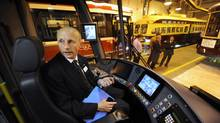 Andy Byford, CEO of the Toronto Transit Commission, poses for a photograph while seated in the driver's seat in TTC's new low-floor, articulated streetcar. (Fred Lum/The Globe and Mail)