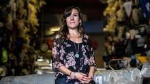Entrepreneur Jenny Hughes has been manufacturing her environmentally responsible reusable shopping bags in Vancouver. But as order sizes increase, should she consider looking elsewhere? (Ben Nelms/The Globe and Mail)