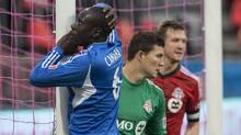 Montreal Impact's Hassoun Camara reacts after a missed goal scoring chance against Toronto FC during second half MLS action in Toronto on Saturday October 26, 2013. (CHRIS YOUNG/THE CANADIAN PRESS)