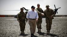 Former U.S. secretary of defense Robert Gates arrives at Combat Outpost Andar in Ghazni Province, Afghanistan, in this June 6, 2011 file photo. His memoirs, published in early January, 2014, have triggered some controversy in Washington. (Jason Reed/REUTERS)