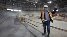 Curt Harnett, Canadian Olympic cyclist, and the Chef de Mission for the Canadian 2015 Pan-Am team, speaks about the new velodrome for the 2015 Pan-Am Games that is nearing completion in Milton, Ont., on Sept. 11, 2014. (Peter Power For The Globe and Mail)