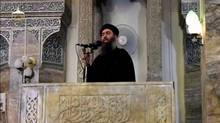 FILE PHOTO: A man purported to be the reclusive leader of the militant Islamic State Abu Bakr al-Baghdadi making what would have been his first public appearance, at a mosque in the centre of Iraq's second city, Mosul, according to a video recording posted on the Internet on July 5, 2014, in this still image taken from video. (REUTERS TV/REUTERS)