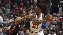 Chicago Bulls forward Jimmy Butler (21) defended by Toronto Raptors guard Kyle Lowry (7) during the first quarter at the United Center in Chicago Jan. 7, 2017. (David Banks/USA Today Sports)
