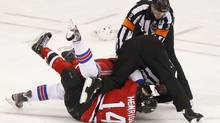 New York Rangers' Ryan McDonagh and New Jersey Devils' Adam Henrique (14) fight during the first period in Game 4 of their NHL Eastern Conference Final hockey playoff game in Newark, New Jersey May 21, 2012. REUTERS/Adam Hunger (ADAM HUNGER)