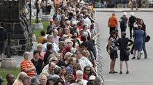Crowds line-up to pay respect to Canada's leader of the Opposition Jack Layton as his body lies-in-state in the Center Block of Parliament Hill in Ottawa on Aug. 24, 2011. (Patrick Doyle/REUTERS/Patrick Doyle/REUTERS)
