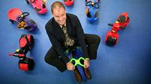 Tim Kimber, CEO of PlaSmart Inc., rides a PlasmaCar in the hall of his office in Ottawa. (Dave Chan/DAVE CHAN FOR THE GLOBE AND MAIL)
