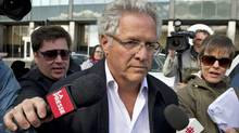 Quebec construction magnate Tony Accurso leaves the Quebec Provincial Police headquarters in Montreal after being arrested for charges of fraud along with 13 others on April 17, 2012. (Paul Chiasson/Paul Chiasson / The Canadian Press)