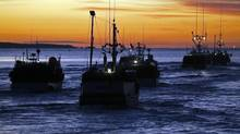 Fishing boats head out to sea from the harbour in West Dover, N.S. (Andrew Vaughan/THE CANADIAN PRESS)