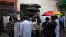 Pakistani media and lawyers gather outside a court, where a case hearing of Christian girl accused of blasphemy, is held in Islamabad, Pakistan on Monday, Sept. 3, 2012. (Anjum Naveed/AP)
