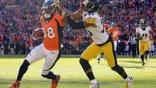 Denver Broncos wide receiver Demaryius Thomas, left, pushes off Pittsburgh Steelers defensive back Brandon Boykin in Denver on Jan. 17. (Joe Mahoney/AP Photo)