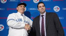 Toronto Blue Jays General Manager Alex Anthopoulos, right, shakes hands with new Blue Jays manager John Gibbons, left, after speaking to he media during a press conference in Toronto on Tuesday, Nov. 20, 2012. (Nathan Denette/THE CANADIAN PRESS)
