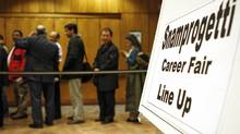 People attend a 2009 job fair in Calgary. (Jeff McIntosh For The Globe and Mail)