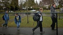 Eric Jamieson arrives MOnday with his three sons at the Shaughnessy Point Grey Out of School Care Society located at Quilchena Elementary school in Vancouver. (Rafal Gerszak for The Globe and Mail/Rafal Gerszak for The Globe and Mail)