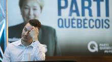 A Parti Quebecois supporter watches early television coverage of election night at the party's reception Monday, April 7, 2014 in Montreal, Que. (Ryan Remiorz/THE CANADIAN PRESS)