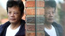 Yao Wei Wu outside his home in Vancouver, B.C., on Jan. 22, 2010, where he was assaulted by police officers who thought he was the suspect in a domestic abuse call. (Darryl Dyck/The Canadian Press)