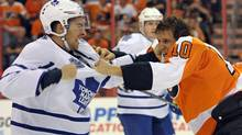 Toronto Maple Leafs right wing Joffrey Lupul (19) fights against Philadelphia Flyers center Brayden Schenn (10) during the first period at the Wells Fargo Center (Eric Hartline/USA TODAY Sports)