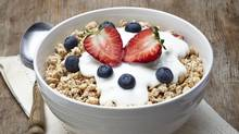 A satisfying breakfast should include at least one protein-rich food, such as Greek yogurt, and low-glycemic carbohydrates like oats and fruit (Baiba Opule/Getty Images/iStockphoto)