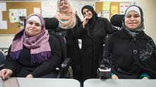 Sisters Hanadi Alsedawe (standing right), Maha Alsedawe, Huda Alsedawe, with their mother Fayzeh Ramadan (standing left) seen here during a break from English class in Coquitlam October 25, 2016. (John Lehmann for The Globe and Mail)