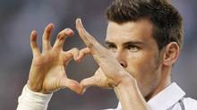 Tottenham Hotspur's Gareth Bale gestures a heart shape after scoring against the Los Angeles Galaxy. (DANNY MOLOSHOK/REUTERS)
