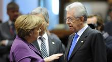 German Chancellor Angela Merkel (L) speaks with Italy Prime Minister Mario Monti before the start of a working session during an European Union summit at the EU headquarters on December 9, 2011 in Brussels. (ERIC FEFERBERG/AFP/Getty Images)