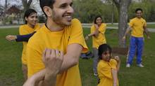Jeev Singh and other members of the Guru Govind Singh Children's Foundation stretch before a practicerun in Brampton for 'inspirational steps,' a full 42 KM marathon that will run on May 19. (J.P. MOCZULSKI/J.P. MOCZULSKI)
