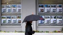 Even rain can't cool off the Vancouver housing market. The Greater Vancouver home price index reached a record of $1,010,000 in January, jumping 8.4 per cent from January, 2014. Detatched housing on Vancouver's west side reached a record of $2,351,300 (DARRYL DYCK/THE GLOBE AND MAIL)