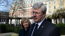 Prime Minister Stephen Harper talks to media in Grosvenor Square Garden with wife Laureen after attending the funeral of Margaret Thatcher in London on Wednesday, April 17, 2013. (Sean Kilpatrick/THE CANADIAN PRESS)