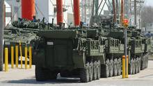 Light Armoured Vehicles (LAV) parked on the lot of the General Dynamics / Land Systems factory where they are built in London, Ont., on Wednesday, April 13, 2016. (Dave Chidley For The Globe and Mail)