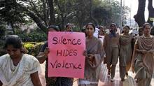 Indian women in Hyderabad participate in a march Thursday to mourn the death of a gang rape victim last month in New Delhi. The Dec. 16 attack on the woman, who later died of her injuries, has caused outrage across India, sparking protests and demands for tough new rape laws, better police protection for women and a sustained campaign to change society's views about women. (Mahesh Kumar A/Associated Press)