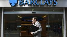 A man walks past a branch of Barclays Bank in the City of London in this file photo. (OLIVIA HARRIS/Reuters)
