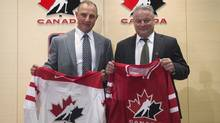 Brent Sutter, left, newly-named coach of the Canada's national junior team and Dale Hunter, newly-named coach of Canada's men's under 18 team, pose for a photo in Toronto on Wednesday, June 26, 2013. (The Canadian Press)