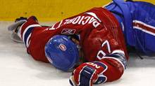 In this file photo, Montreal Canadiens Max Pacioretty lies on the ice after being hit into a glass stanchion by Boston Bruins Zdeno Chara during the second period of NHL hockey play in Montreal, March 8, 2011.  Pacioretty suffered a broken vertebra and severe concussion on the play. (Shaun Best/REUTERS)