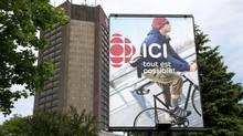 The new name for Radio-Canada, Ici, is seen on a billboard next to its building on Wednesday, June 5, 2013 in Montreal. (THE CANADIAN PRESS)