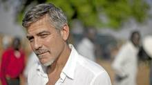 American actor and activist, George Clooney, outside a polling station on the first day of voting in the southern Sudanese capital city of Juba on Sunday, Jan. 9, 2011. Clooney is visiting southern Sudan in a bid to draw attention to the situation as southern Sudanese prepare to vote in an independence referendum that will determine whether the region secedes from the north to form the world's newest country. (Pete Muller/AP/Pete Muller/AP)
