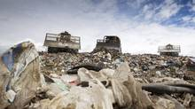 A bulldozer pushes garbage around at Vancouver landfill in Delta, B.C., in this July, 2011 file photo. (JOHN LEHMANN/The Globe and Mail)