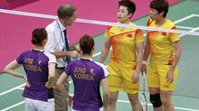 An official speaks to players from China and South Korea during their women's doubles group play stage Group A badminton match during the London 2012 Olympic Games at the Wembley Arena July 31, 2012. Tournament officials are investigating a women's badminton doubles match between China and South Korea at the London Games on Tuesday after both teams appeared determined to lose. (BAZUKI MUHAMMAD/REUTERS)