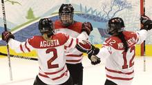 Canada's Marie-Philip Poulin celebrates the second of her two first-period goals with teammates Meghan Agosta and Meaghan Mikkelson during the gold medal game played at Canada Hockey Place in Vancouver during the 2010 Olympic Games. (Peter Power/Peter Power/The Globe and Mail)