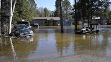 Flood waters surround houses and vehicles in Hunstville, Ont., April 21, 2013, 2013. (J.P. MOCZULSKI for The Globe and Mail)